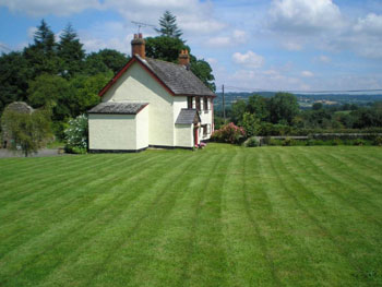 Lydensign is a spacious 3 bedroom detached cottage set in almost an acre of lawns, where you can come to relax, maybe sit by the pond with a glass of wine or cuppa or curl up in front of the glowing log fire.