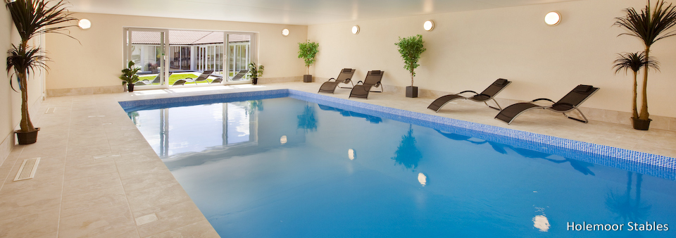 Holiday cottages with a swimming pool and barbeque  in Somerset, South West of England
