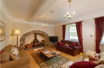 Logie Country House lounge with log fire