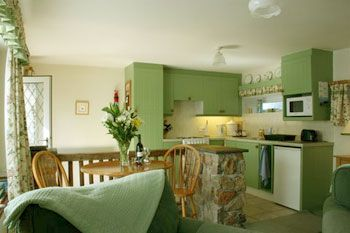 Fresh green colour scheme inside this cottage for 2