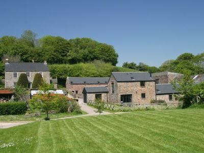 Self-catering cottage with own enclosed garden and sundeck overlooking the lily pond