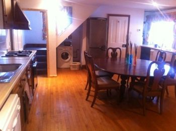 Large kitchen and dining area with a wood stove