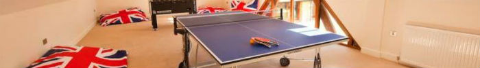 Games room at holiday house with table tennis and other games